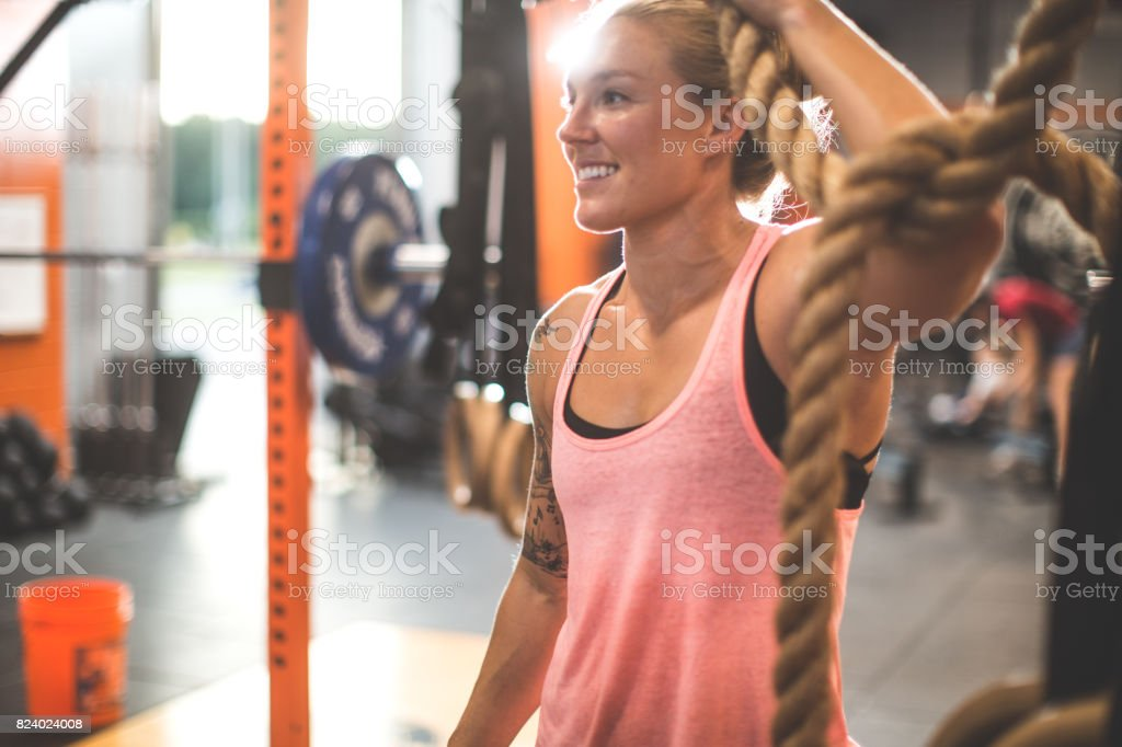 Young women athletes cross trianing workout in the gym. stock photo
