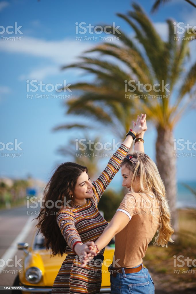 Young women being silly on tropical vacations road trip royalty-free stock photo