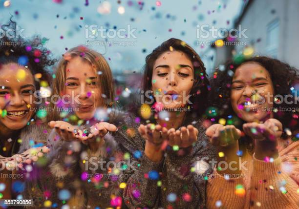 Young women blowing confetti from hands picture id858790856?b=1&k=6&m=858790856&s=612x612&h=vl8an3q37sg0o lcjp2hnz3o4x2uwz5h w02hwky0be=