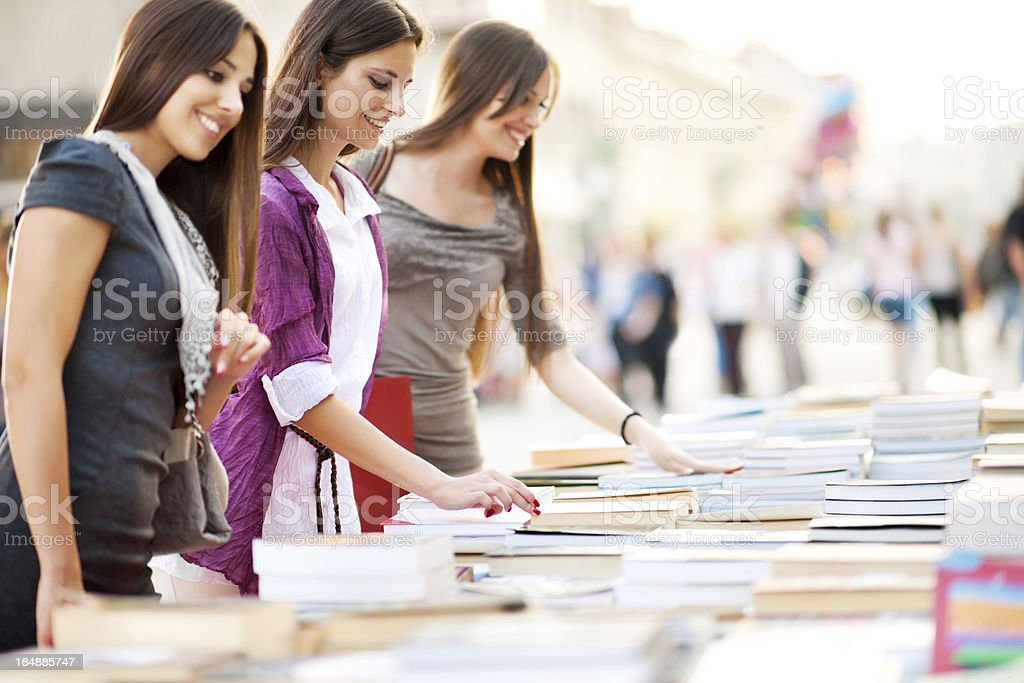 Young women buying books. stock photo