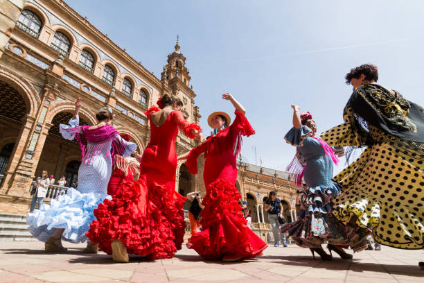 Young women dance flamenco on Plaza de Espana in Seville, Spain stock photo