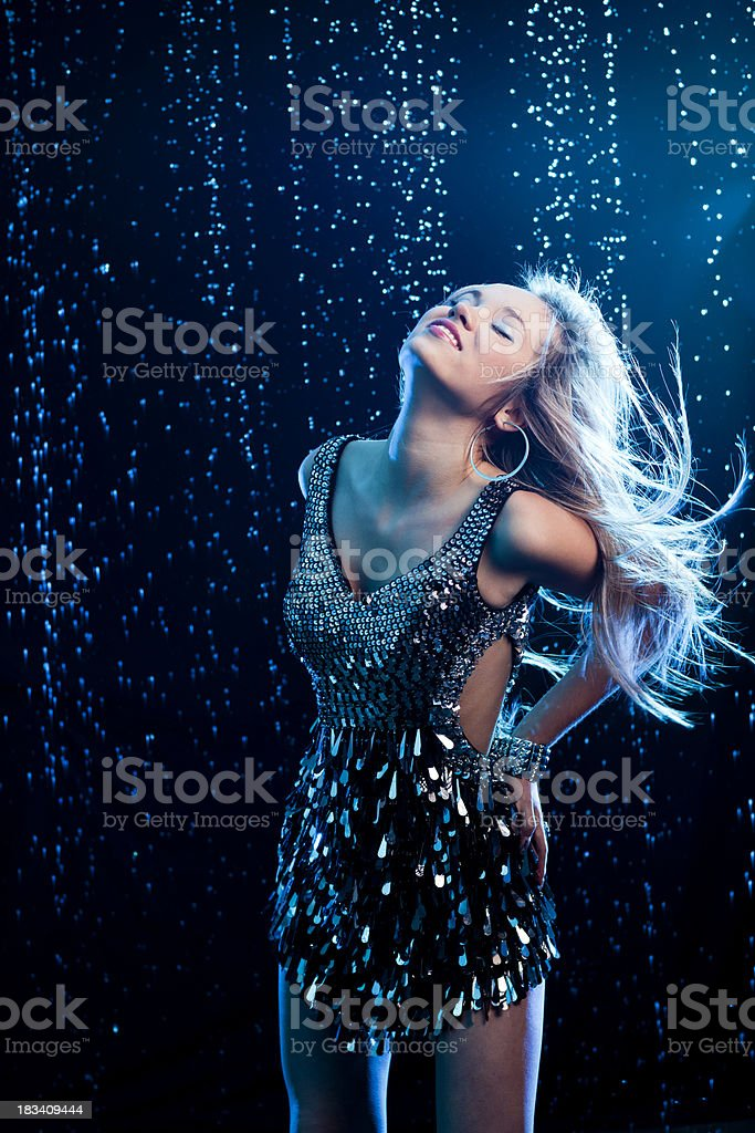 Young women dance on rainy background stock photo