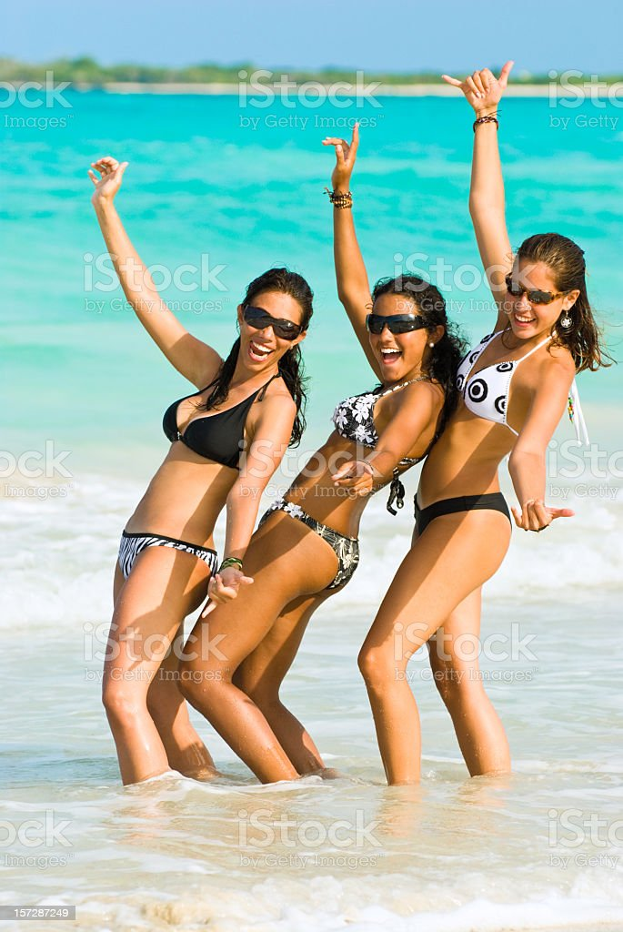 Young Women dancing in a beach royalty-free stock photo