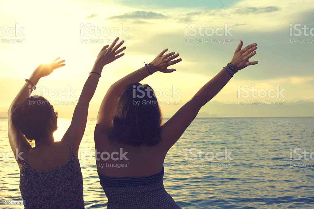 young women do the wave at a party at sea stock photo