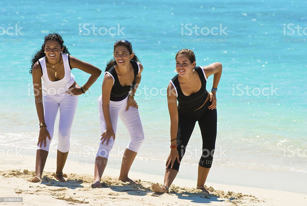 Young women doing aerobics on a tropical beach royalty-free stock photo