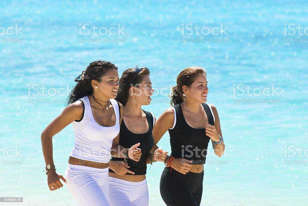 Young women doing aerobics on a tropical beach stock photo