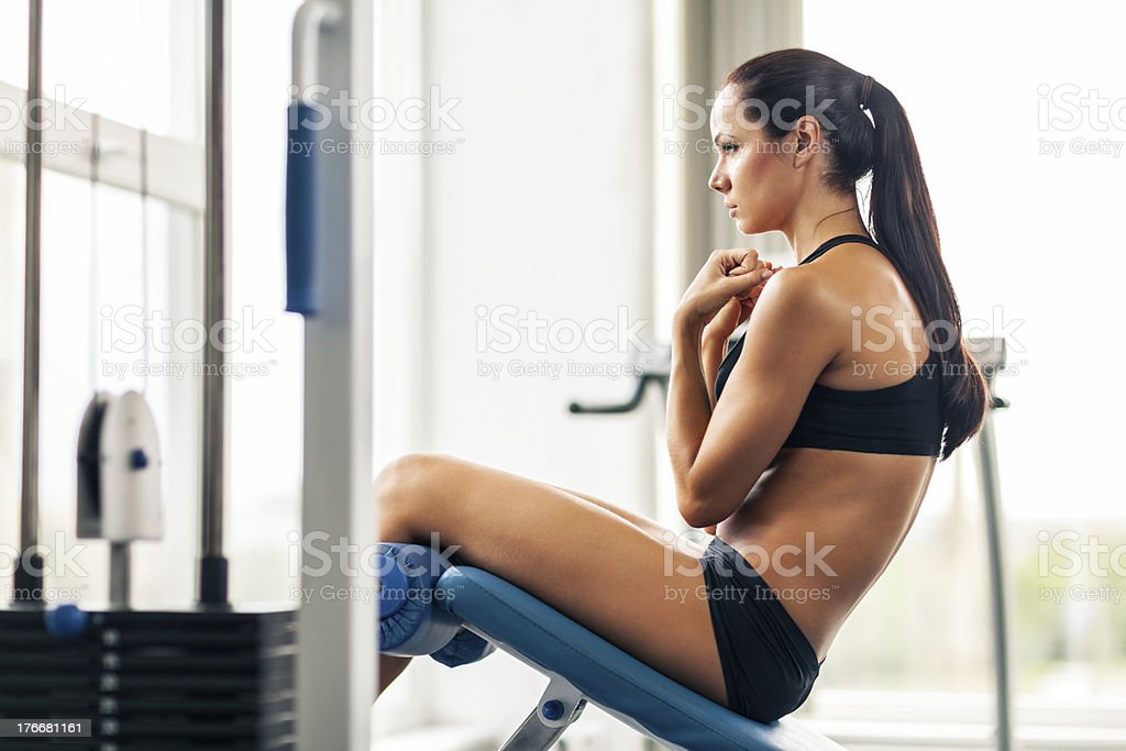 Young women doing crunches royalty-free stock photo