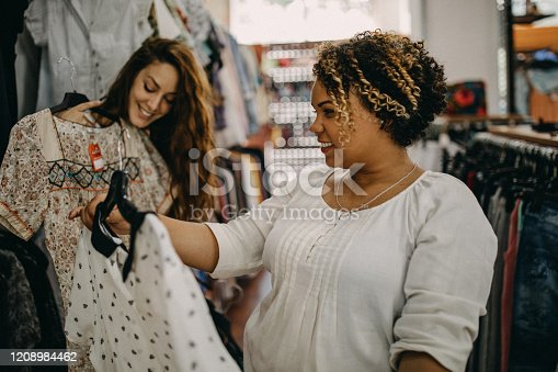 Young women doing vintage shopping