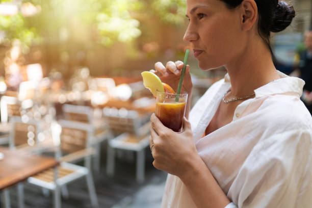 Young women drinking fresh juice stock photo