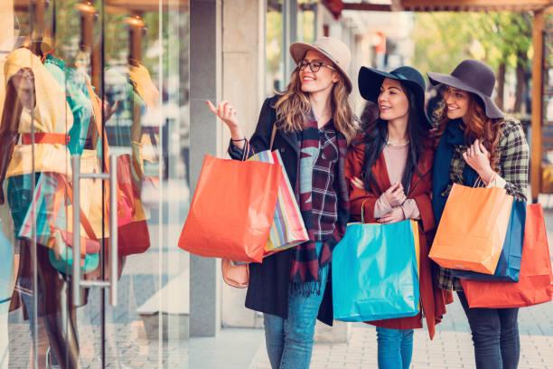 Young women enjoying a window shopping stock photo