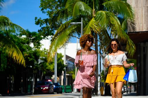 Young women enjoying city life on sunny day