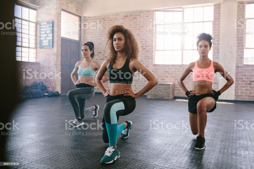 Young women exercising in aerobics class royalty-free stock photo
