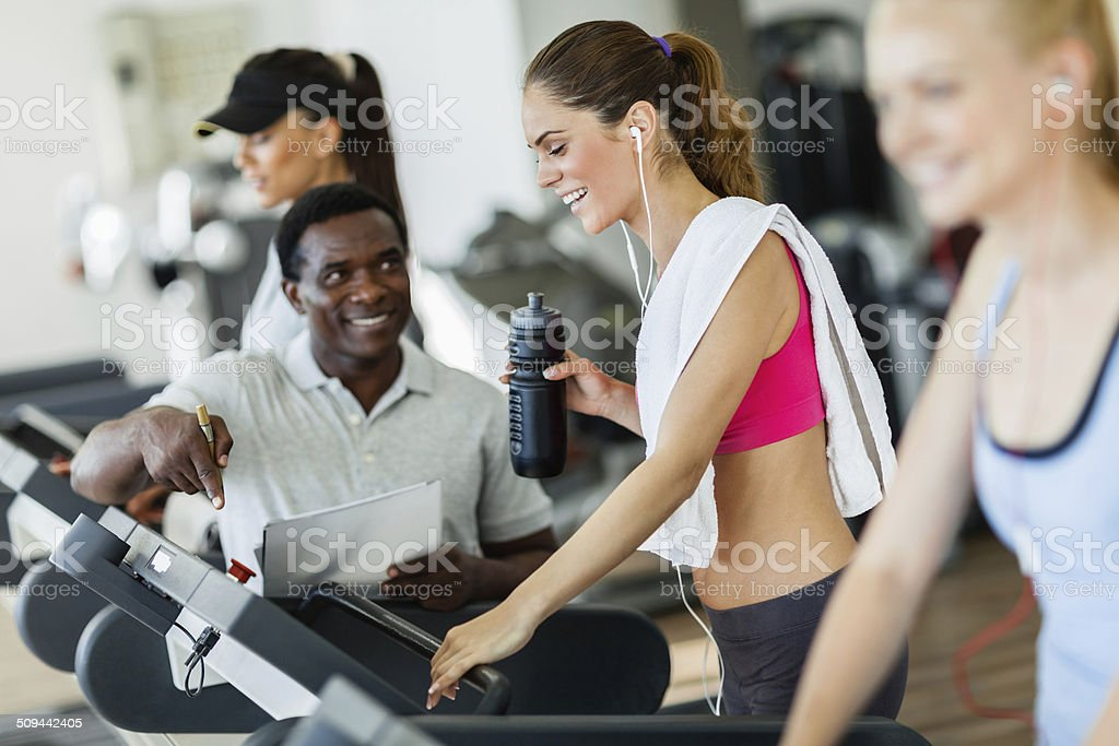Young women exercising in gym stock photo