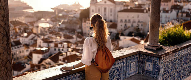 istock Young women exploring streets of southern Iberic european city 1184184849