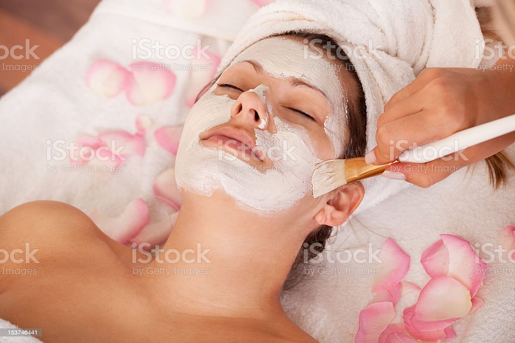 Young women getting facial mask royalty-free stock photo