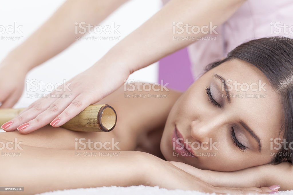 A young women getting her muscles rolled out stock photo