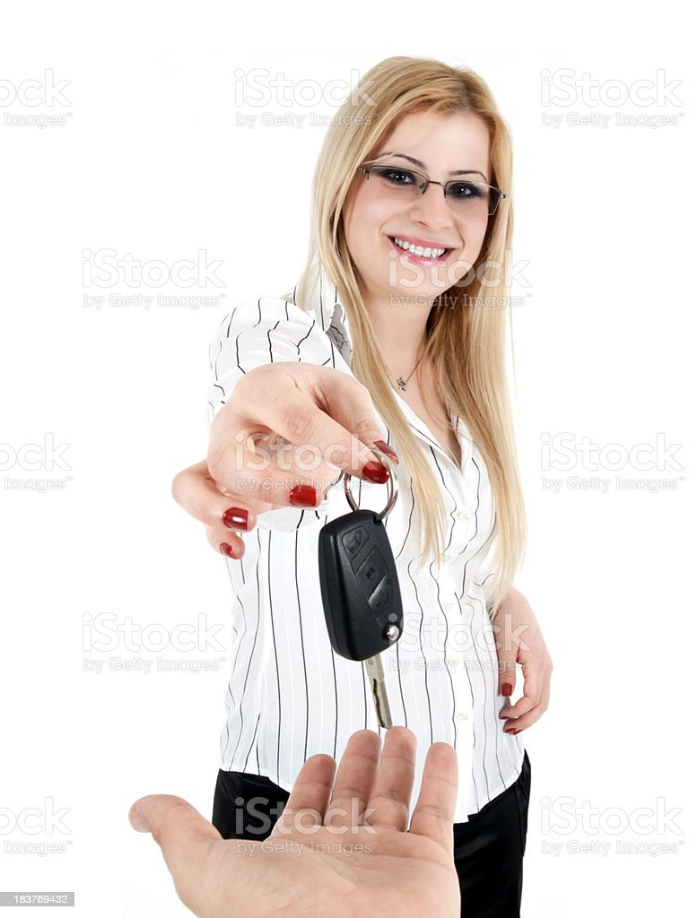 young women gives car key royalty-free stock photo