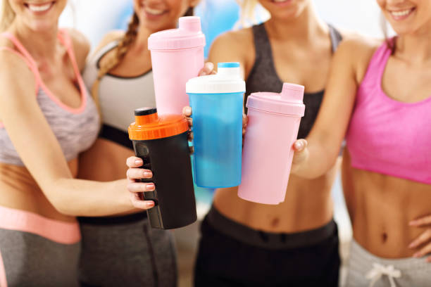 young women group resting at the gym after workout - protein stock photos and pictures