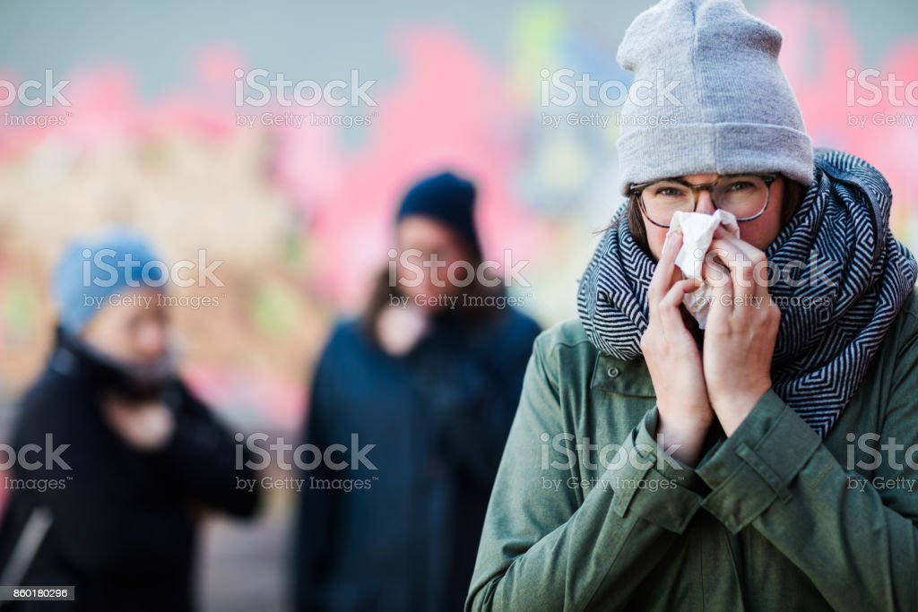 Young women having a cold stock photo