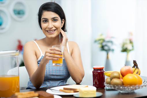 young women having breakfast at home, stock photo