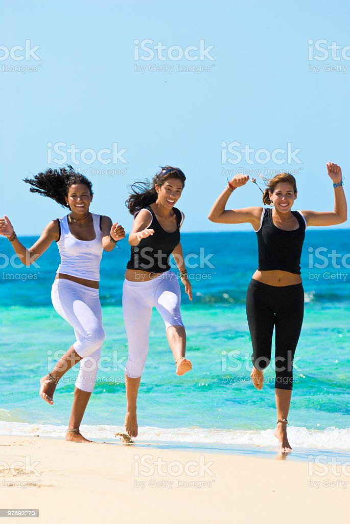 Young Women having fun in a beach royalty-free stock photo