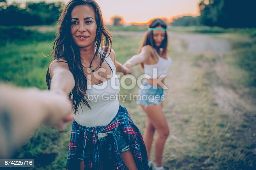 516318379 istock photo Young women having great time in the nature 874225716
