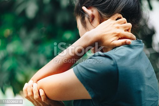 istock young women having pain in injured arm , office syndrome , health care concept 1152095318