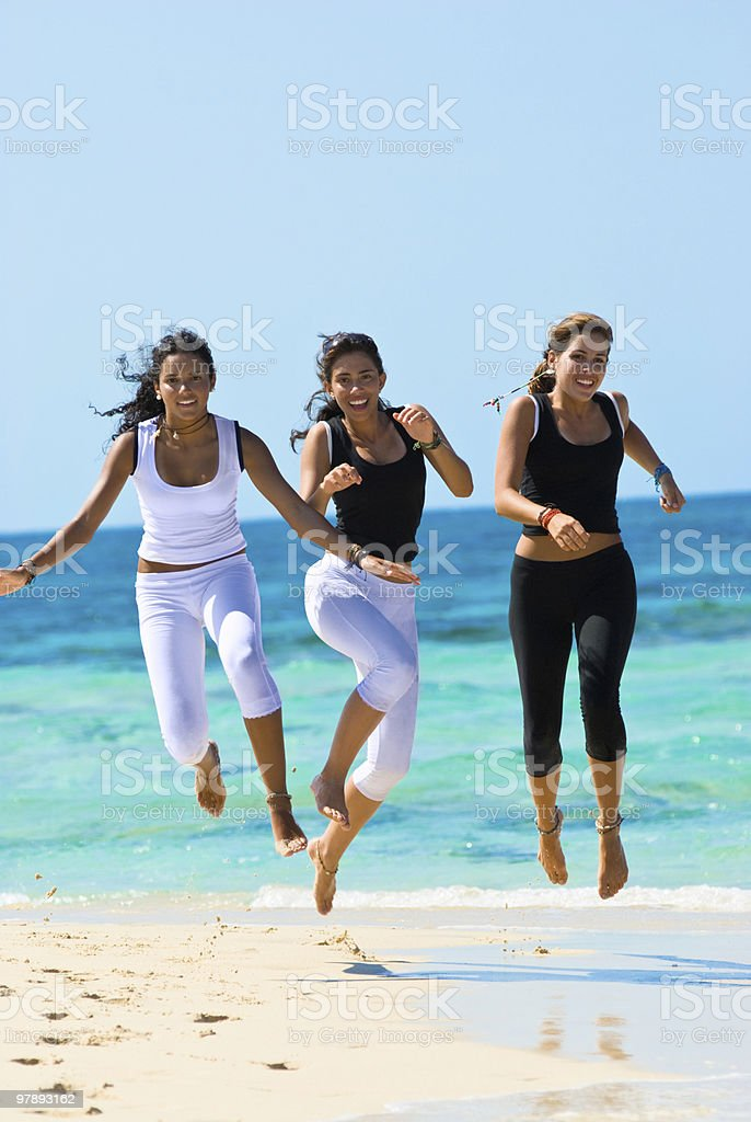 Young Women havong fun in a beach royalty-free stock photo