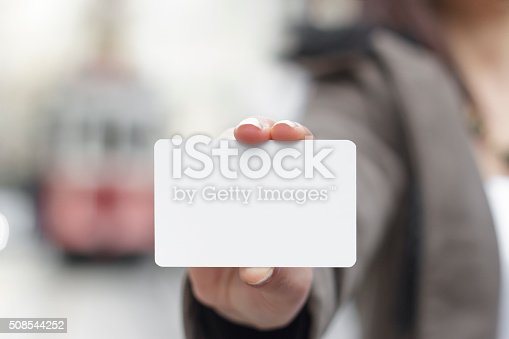 Young women holding a blank card in hands