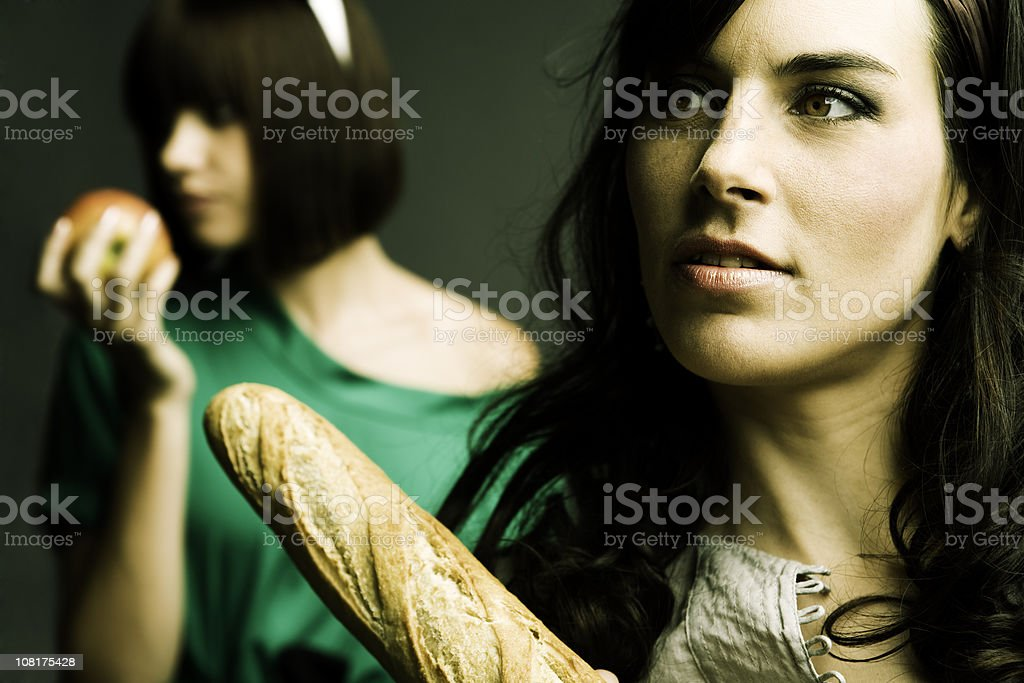 Young Women Holding Bread and Fruit royalty-free stock photo