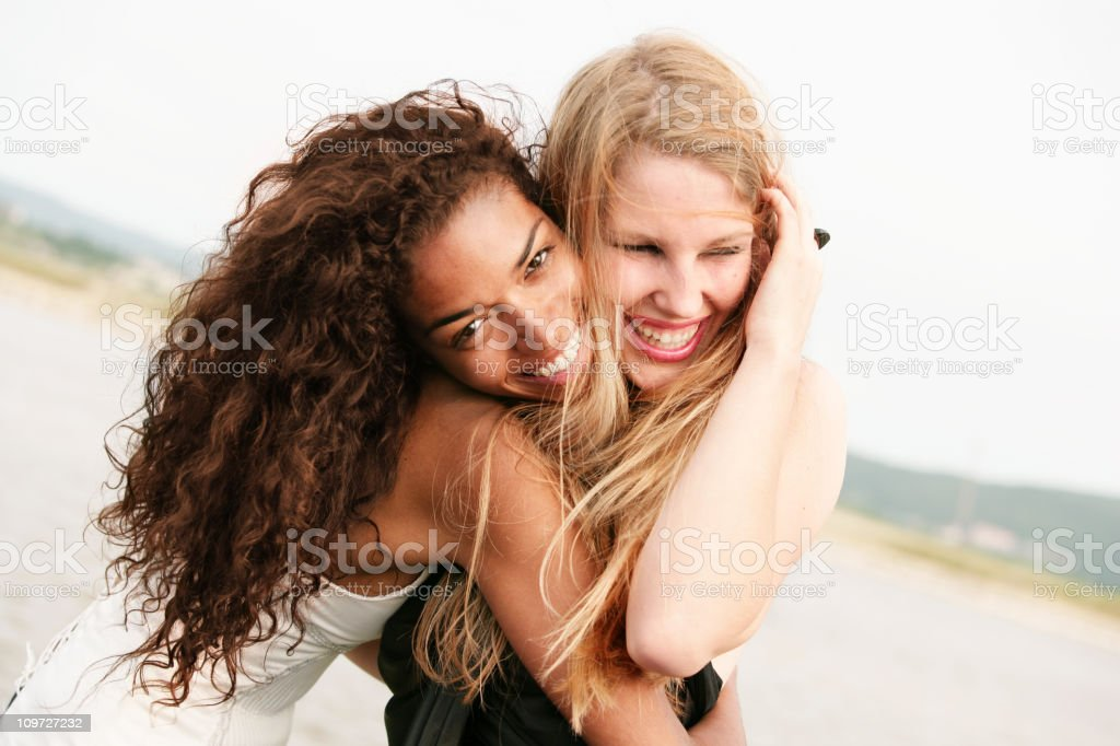 Young Women Hugging and Laughing Friends royalty-free stock photo