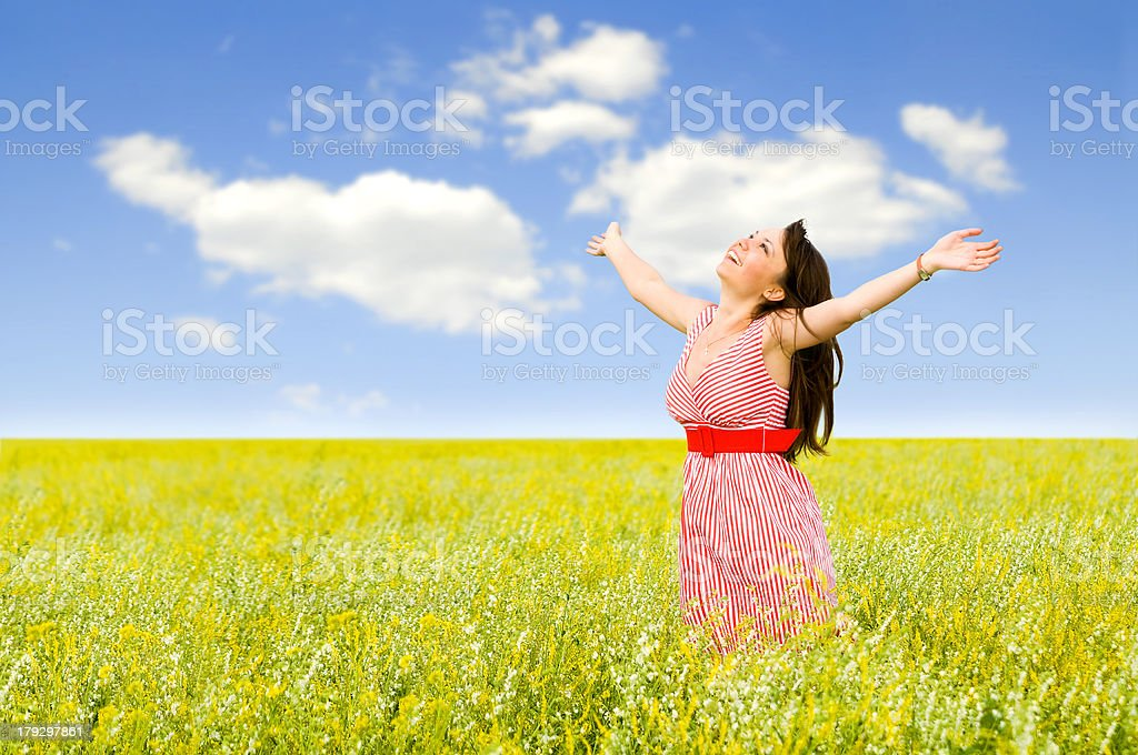 young women  in a field royalty-free stock photo