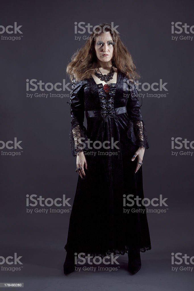 Young women in black long dress royalty-free stock photo