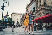 Young women in Budapest crossing the street at the pedestrian walkway