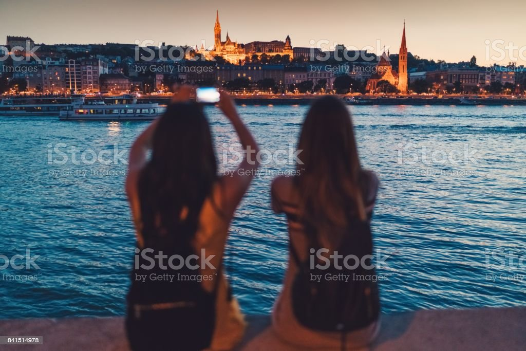 Young women in Budapest taking photos stock photo