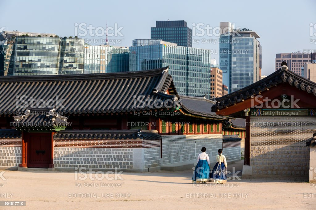 Young women in colorful traditional wear - hanbok visiting the Gyeongbokgung Palace. royalty-free stock photo