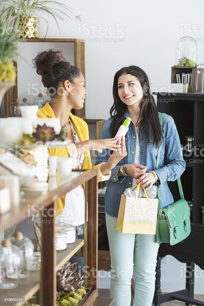 Young women in retail shop stock photo