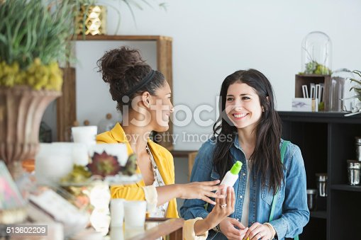 istock Young women in retail shop 513602209