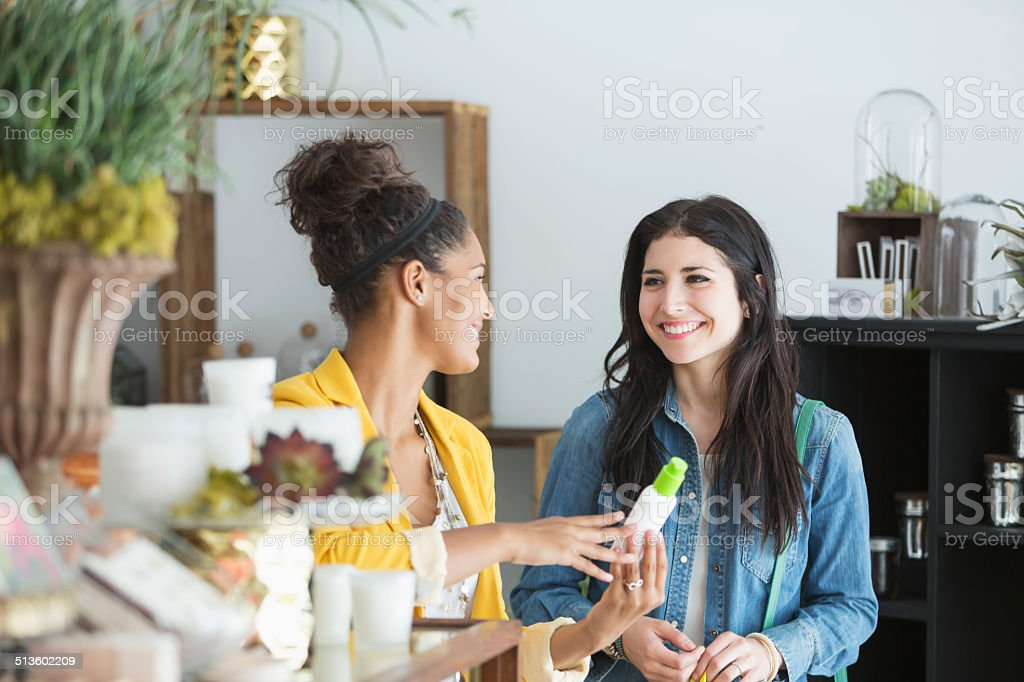 Young women in retail shop stock photo