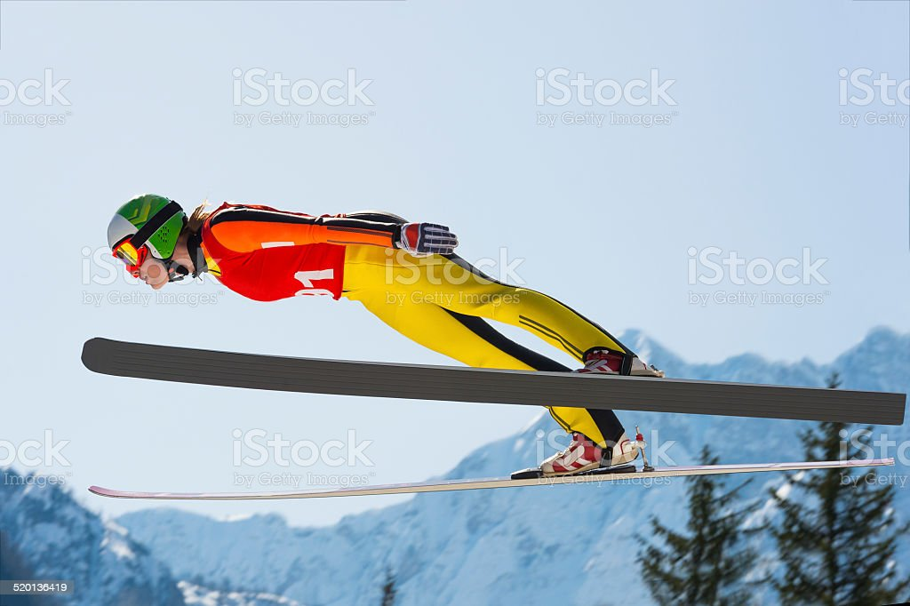 Young Women  in Ski Jumping Action stock photo