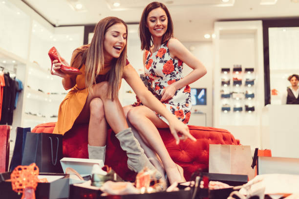 Young women in the shopping mall stock photo