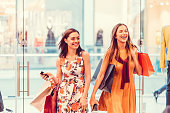 Happy women in the shopping mall enjoying the day