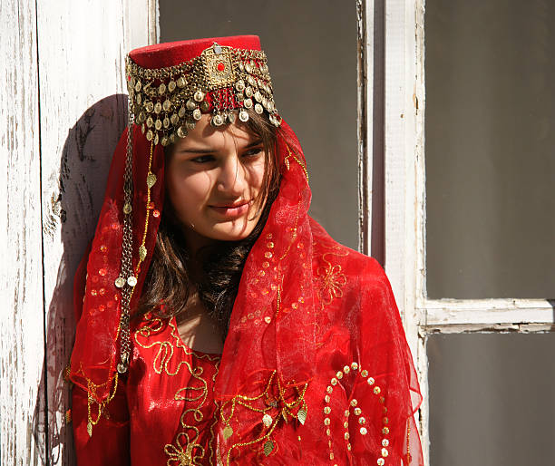 young women in traditional wedding dress stock photo