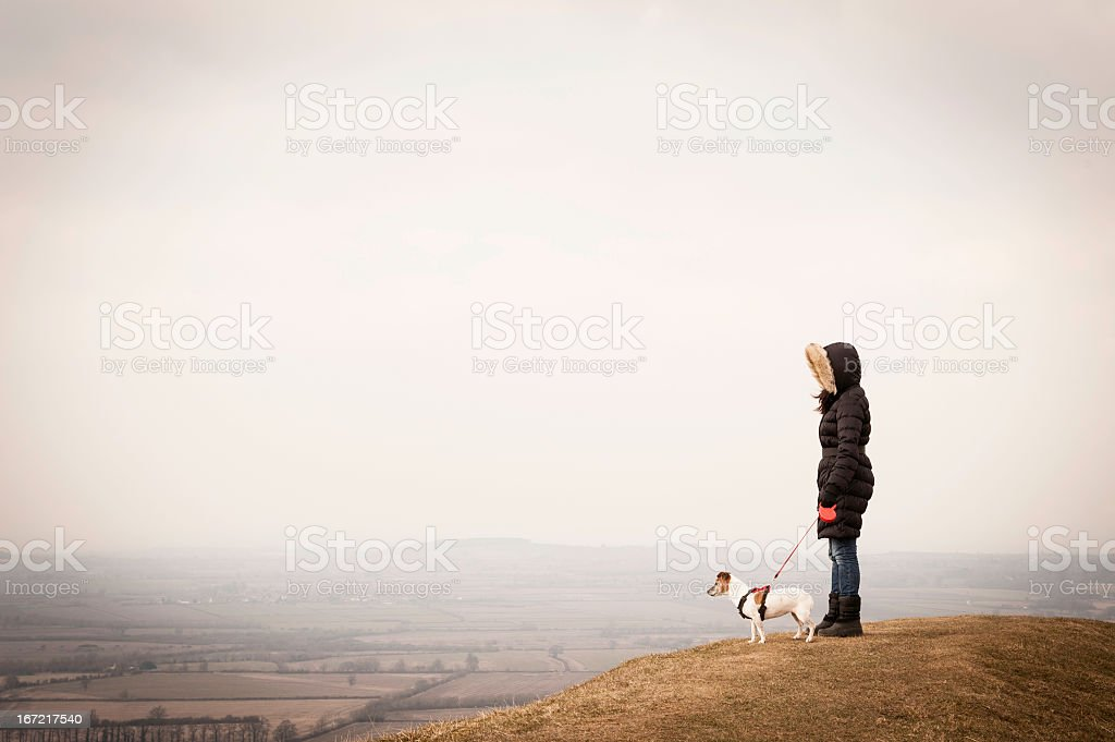 Young Women in Winter coat with Jack Russell Dog royalty-free stock photo