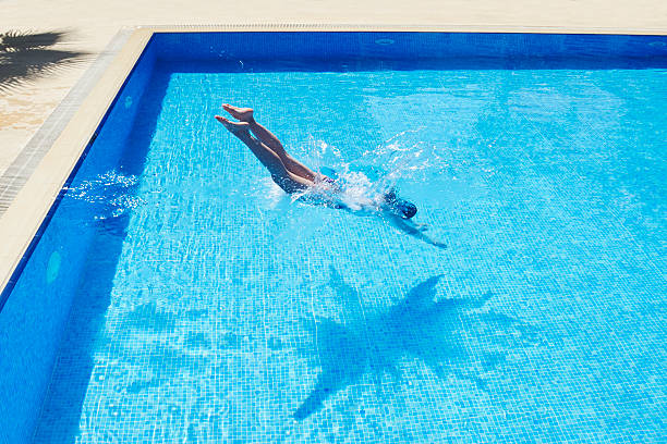 Young Women is Swimming in the Pool stock photo