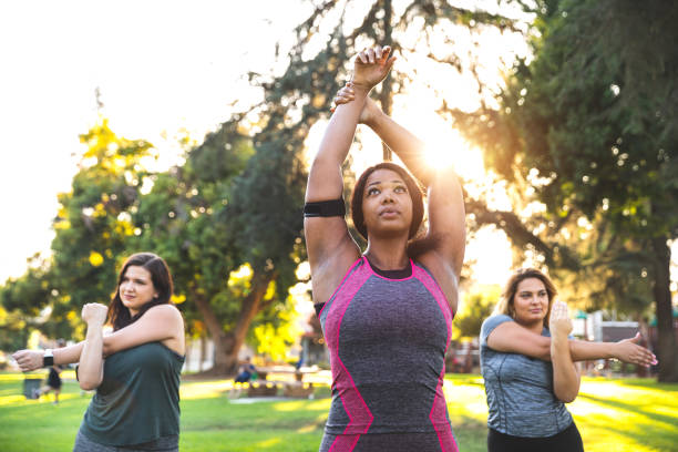 Young women jogging and getting healthy at the park stock photo