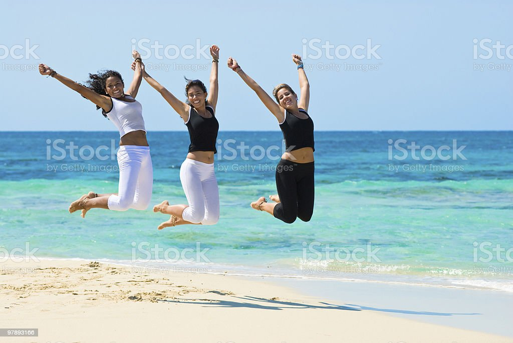 Young Women jumping in a beach royalty-free stock photo