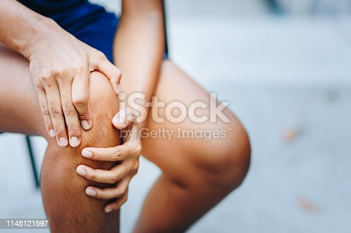 istock young women knee ache, healthcare concept 1145121597