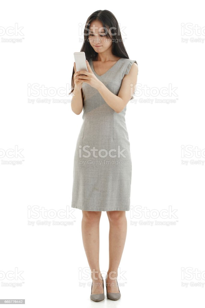 Young women look at mobile phones stock photo