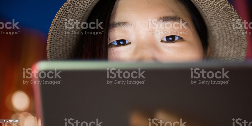 young women looking at digital tablet stock photo
